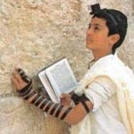 Boy praying at Western Wall